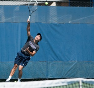 Juan Canales serves the ball. (Universe Photo)