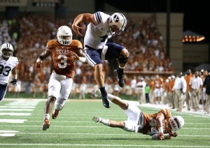Taysom Hill leaps over a Texas defender for a touchdown (BYU photo/Mark Philbrick)