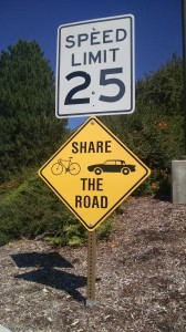 """The recent installments of """"Share the Road"""" signs around BYU campus can be a friendly reminder to bikers and drivers to pay attention to road rules. (Photo by Tatiana Hernandez)"""