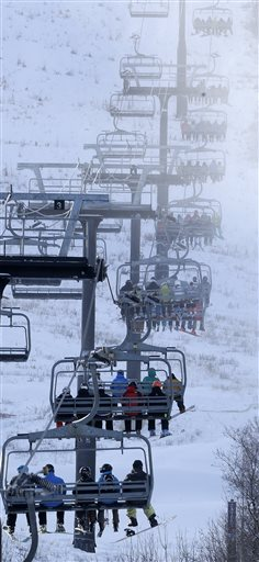 Skiers and snowboarders sit on a lift at Park City Mountain Resort, in Park City, Utah. Vail Resorts Inc. is planning to begin building lifts this summer to connect Canyons Resort and its newest acquisition, Park City Mountain Resort. The Salt Lake Tribune reports that Vail Chief Executive Rob Katz said in the company's financial report for the fiscal year that they will be looking to upgrade or add new lifts, restaurants and snowmakers. (AP Photo/Rick Bowmer, File)