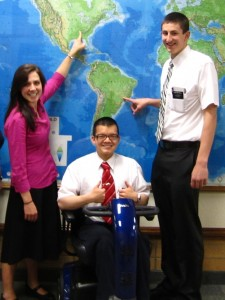 Zayne Callahan sits with Natalie Bishop, (left) and Alex Mitchell, (right,) in front of the MTC world map . Callahan served an MTC referral center mission. (Zayne Callahan)