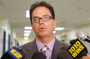 Dr. Richard Labbe speaks to the media about the cancellation of the football season at Sayreville War Memorial High School. (AP Photo/The Star-Ledger, William Perlman)