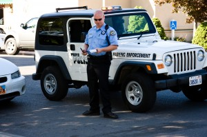 A Provo police officer issues parking tickets just south of the BYU campus. Parking may be one of the biggest worries for a BYU student with a car. (Drew Van Wagenen)