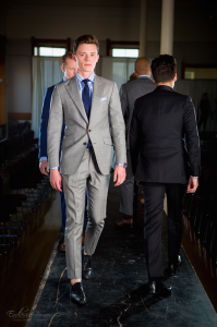 BYU student Stafford Thomas does the catwalk in a Beckett & Robb custom suit at Provo Fashion Week Oct. 11. (Mike Johnson)