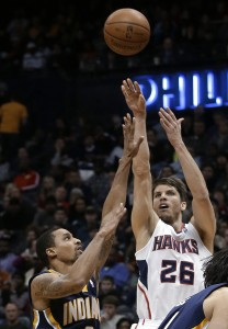 Atlanta Hawks guard Kyle Korver (26) releases a 3-point shot as Indiana Pacers point guard George Hill defends (AP Photo/John Bazemore, File)