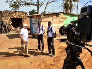 Director Garrett Batty coaches Clement Amegayie and Philip Michael as their characters prepare to flee Liberian Rebels. Freetown is a religious thriller coming to theaters April 8th, 2015. (Photo courtesy of Three Coin Productions)