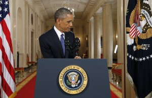 """President Barack Obama leaves the podium after speaking during a nationally televised address from the White House in Washington, Thursday, Nov. 20, 2014. Spurning furious Republicans, President Barack Obama unveiled expansive executive actions on immigration Thursday night to spare nearly 5 million people in the U.S. illegally from deportation and refocus enforcement efforts on """"felons, not families."""" (AP Photo/Jim Bourg, Pool)"""
