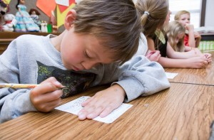 An elementary school student in Provo considers his homework. Many teachers in Provo schools have expressed support for Common Core, despite it being controversial.