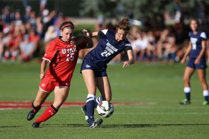 Sephanie Ringwood takes the ball away from a University of Utah player on September 5, 2014 (Universe Photo.)