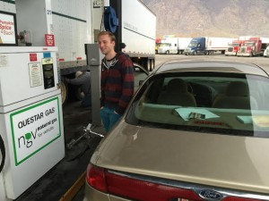 Ryan Freeman, a senior studying English, fills up his car with compressed natural gas. Freeman uses it because of how cheap it is compared to regular gasoline; he filled up is car for $7.96. (Frank Young)
