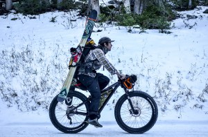 Mike Schneider riding his bike to the slopes to ride some back country powder. Schneider is the founder and president of Surface, who manufacture a wide range of skis. (Mike Schneider)