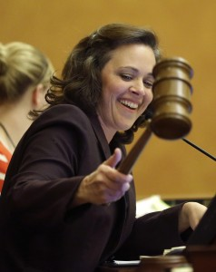 Speaker of the Utah House of Representatives, Becky Lockhart, uses a gavel after finishing business at the Utah State Capitol. Lockhart, the first female speaker in the history of the Utah House of Representatives, has died of a rare brain disease at the age of 46. (AP Photo/Rick Bowmer, File)