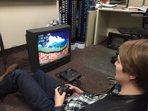 Hunter Phillips tests games and TVs for the History of Video Games Exhibit. BYU will hold its first Video Games Symposium Feb. 12- Feb. 14. (Video Games Symposium FB Page)