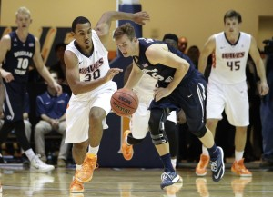 Pepperdine's Lamond Murray Jr, center left, and BYU's Kyle Collinsworth chase a loose ball during the second half of an NCAA college basketball game Thursday, Feb. 5, 2015, in Malibu, Calif. Pepperdine won 80-74. (AP Photo/Jae C. Hong)