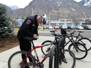 BYU Police Department officer Carl Whiting writes a ticket for an unregistered bicycle on campus. Whiting has been at BYU for 11 years, but previously worked for the Los Angeles Police Department for 26 years. (Alyssa Blake)