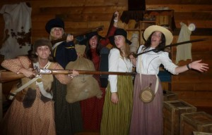 MaryKathryn Herman poses with fellow missionaries at a model cabin at the Mormon Battalion Historic Site Museum. Herman thought her mission would be like serving at Temple Square, but it turned out quite differently. (MaryKathryn Herman)