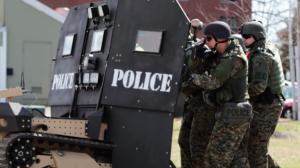 S.W.A.T. team in Utah moves in on suspect in a standoff (photo courtesy of Brad Barber and Scott Christopherson).