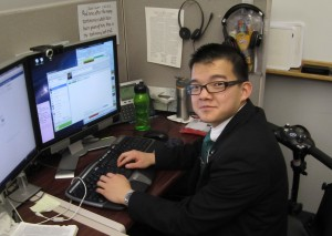Zayne Callahan answers messages from online investigators at the Provo MTC Referral Center. Callahan, who was born with spina bifida, served two years at the referral center. (Courtesy of Zayne Callahan)