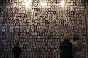 Visitors look at portraits of victims at the Holocaust Museum in the town of Kalavryta, western Greece. (Associated Press)
