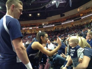 BYU cheerleader Molly Harmon high-fives a BYU fan during the 2015 WCC championship game. (Tori Crane)