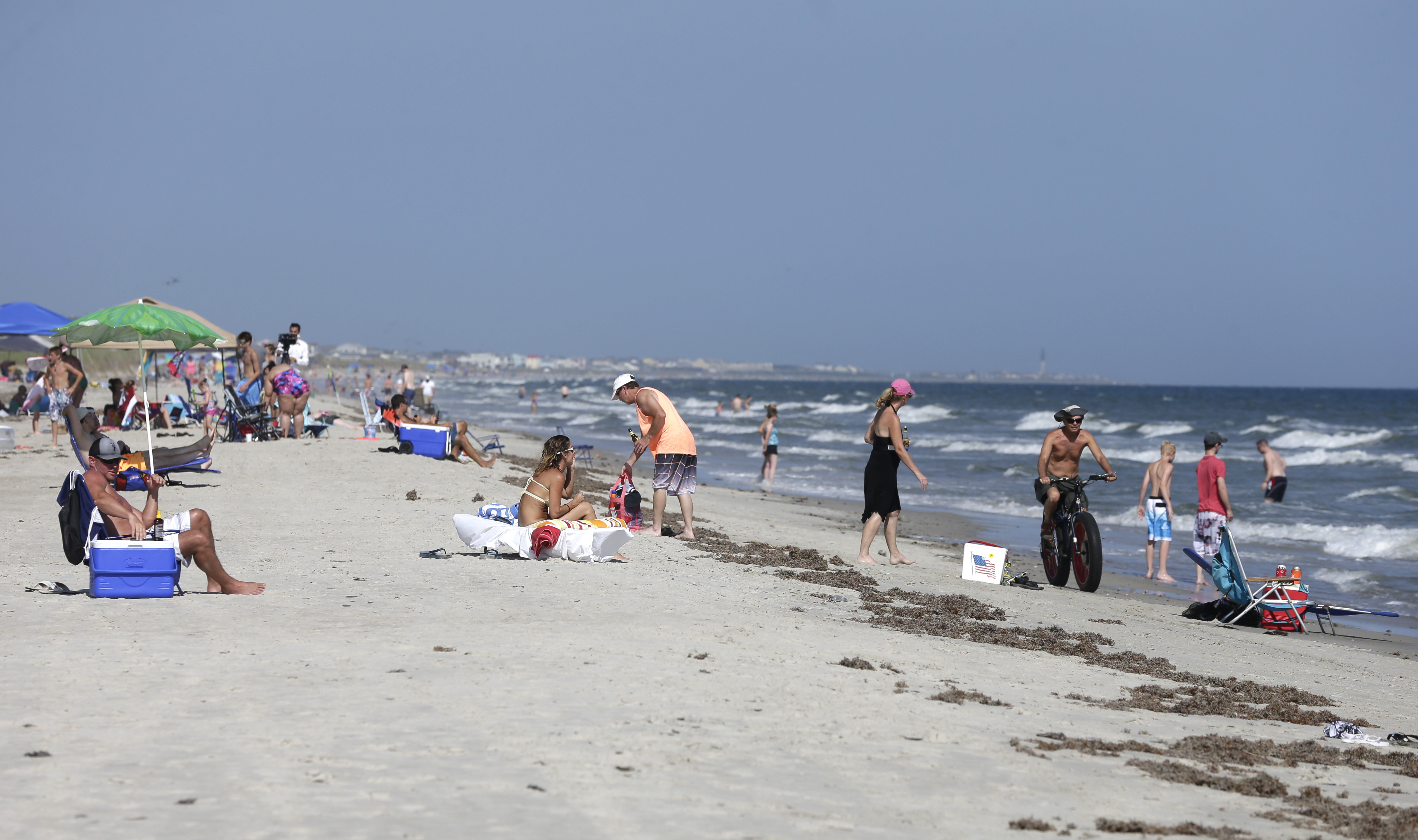 Vacationers Relax On The Bench And In Surf Oak Island N C Monday