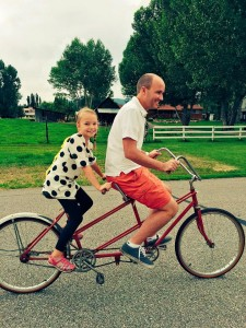 Lt. Governor Spencer Cox and his daughter enjoy a summer bike ride on the farm.  Spencer and his wife,  Abby are grateful for the lesson that living in a small town can teach their children. (Spencer J. Cox)