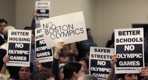 A group of people protest against Boston holding the Olympic games in 2024. Los Angeles may step in to take the bid. (AP photo)