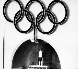 Olympic Gold Medalist Rafer Johnson lights the Olympic torch during the Opening Ceremonies of the 1984 Olympic Games in Los Angeles. If Los Angeles steps in for the 2024 Olympic bid, it would be the city's third time hosting the games. (AP photo)