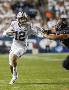 BYU quarterback Tanner Magnum runs the ball in the win against Boise State.  The Cougars beat the Broncos 35-24 with a last minute Hail Mary. (Ari Davis)