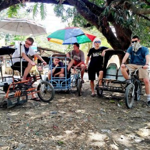 "Members of the Hey Joe Show sit on Trisikads in the Philippines during their summer tour. ""Public transportation at its finest,"" joked Mingus. (Hey Joe Show)"
