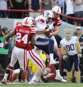 BYU wide receiver Mitch Mathews, center, catches the game-winning touchdown between Nebraska defensive back Aaron Williams (24) and safety Nate Gerry (25) as time runs out in the fourth quarter of an NCAA college football game, to give BYU a 33-28 victory over Nebraska at Memorial Stadium on Saturday, Sept. 5, 2015 in Lincoln, Neb. (Eric Gregory/The Journal-Star via AP) LOCAL TELEVISION OUT; KOLN-TV OUT; KGIN-TV OUT; KLKN-TV OUT; MANDATORY CREDIT