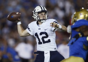 Tanner Mangum passes the ball in the one-point loss to UCLA. (Associated Press)