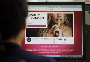 A June 10, 2015 file photo shows Ashley Madison's Korean web site on a computer screen in Seoul, South Korea. Contrary to the hacked Ashley Madison cheaters' site that offers anonymous opportunities for affairs, infidelity more often includes somebody a child actually knows: a family friend, a neighbor, a parent from Little League or the PTA, therapists and divorce attorneys said. That means the third party may become a permanent fixture in the lives of children going forward, forcing an entirely new context on young people as they attempt to sort out villains from victims. (AP Photo/Lee Jin-man, File)