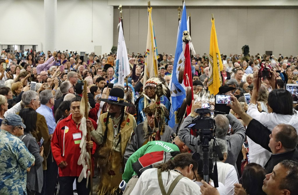 In this photo taken on Thursday, Oct. 15, 2015, members of the Ute Tribe lead the procession for the opening plenary at the 2015 Parliament of the World's Religions held inside the Salt Palace Convention Center in Salt Lake City. Visitors from 80 countries and 50 different religions arrived in Salt Lake City to attend the interfaith conference being held in the United States for the first time since 1993. (Lennis Mahler/The Salt Lake Tribune via AP) DESERET NEWS OUT; LOCAL TELEVISION OUT; MAGS OUT; MANDATORY CREDIT