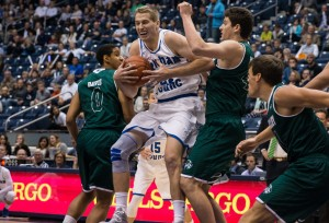 Kyle Davis rebounds the ball against UVU. Davis will need to play a major role defensively against Utah and Colorado. (Maddi Driggs)