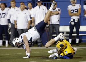 BYU's Remington Peck leaps over San Jose State cornerback Jimmy Pruitt after a catch in the Cougars' 17-16 win over San Jose State on Nov. 6, 2015. (AP Photo)