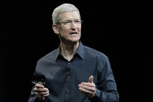 """FILE - In this June 2, 2014, file photo, Apple CEO Tim Cook speaks at an event in San Francisco. The deadly attacks in Paris may soon reopen the debate over whether and how tech companies should let the government sidestep the data scrambling that shields everyday commerce and daily digital life alike. The Obama administration continues to encourage tech companies to include backdoors, although it says it will not ask Congress for new law that requires them. Cook has said that the trouble with that approach is that """"there's no such thing as a backdoor for the good guys only."""" (AP Photo/Jeff Chiu, File)"""