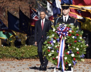 President Barack Obama arrives to lay a wreath at the Tomb of the Unknowns, Wednesday, Nov. 11, 2015, at Arlington National Cemetery in Arlington, Va. during Veterans Day ceremonies. (AP Photo/Susan Walsh)