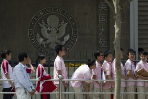 FILE -- In this May 2012 file photo, Chinese students wait outside the U.S. Embassy for their visa application interviews in Beijing, China. The number of international students studying at U.S. colleges increased by 10 percent last year, marking the largest single-year gain in 35 years, according to new federal data. (AP Photo/Alexander F. Yuan, File)