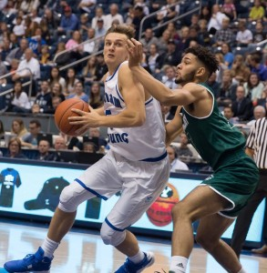 Kyle Collinsworth drives to the basket against UVU. Collinsworth committed six turnovers in the Cougars loss to Long Beach State. (Maddi Driggs)