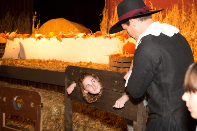 A young girl gets put in the stockade for not being in costume. (Rachel Olsen)