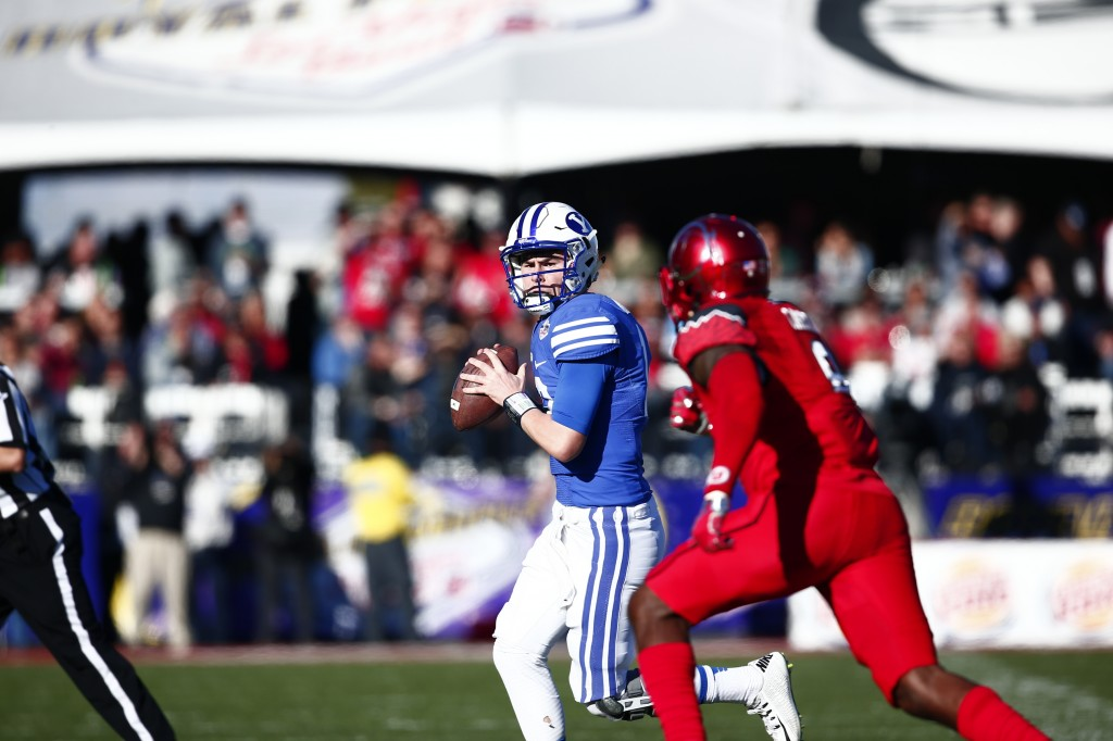 Tanner Mangum looks to throw the ball at the 2015 Las Vegas Bowl. SENTENCE ABOUT WINNING OR LOSING HERE. (BYU Photo)