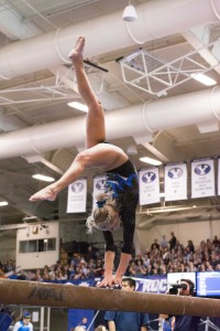 Makenzie Halliday competes on the balance beam during the meet against Boise State and UC Davis. BYU placed second on the night with a score of 195.475.