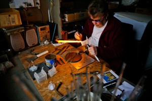 Marge Rosebrook uses an acetylene torch to melt glass into a replica of the Manti LDS Temple on Wednesday, Dec. 16, 2015 in a small workshop shed outside her home in Provo. ( AP)