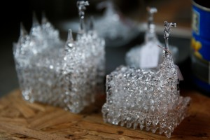 Small glass temples sit on Marge Rosebrook's work table on Wednesday, Dec. 16, 2015 in a small workshop shed outside her home in Provo. (AP)
