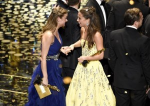 """Brie Larson, best actress winner for """"Room,"""" left, and Alicia Vikander, winner of the best supporting actress award for """"The Danish Girl,"""" congratulate each other on stage at the conclusion of the show at the Oscars on Sunday, Feb. 28, 2016, at the Dolby Theatre in Los Angeles. (Photo by Chris Pizzello/Invision/AP)"""