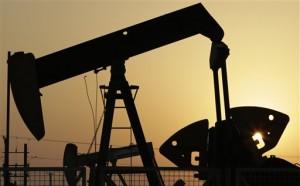 Oil pumps work in the desert oil fields of Sakhir, Bahrain.(Associated Press)