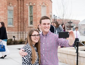 Aubrey Hunt and Kyler Sant take a selfie in front of the Provo City Center Temple.