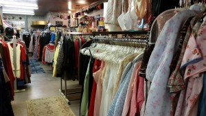 Shopping the racks at Decades. (Decades Store)