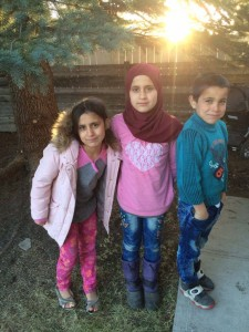Even though there is a language barrier, Amanda Buessecker's family has become close to their new Syrian neighbors. In Calgary, the mother is relieved as the children play in the neighborhood park without the threat of warfare. (Courtesy of Amanda Buessecker)